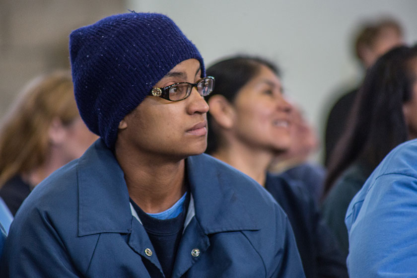 female prisoner listens at hope event