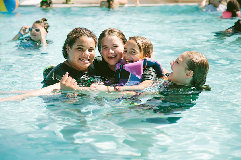 angel tree kids play in camp agape's swimming pool