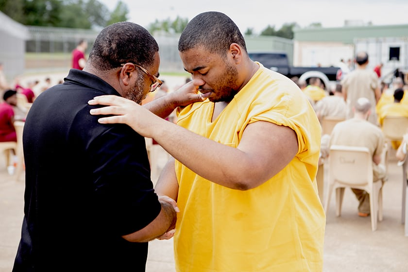man prays with prisoner at carol s vance unit in houston texas